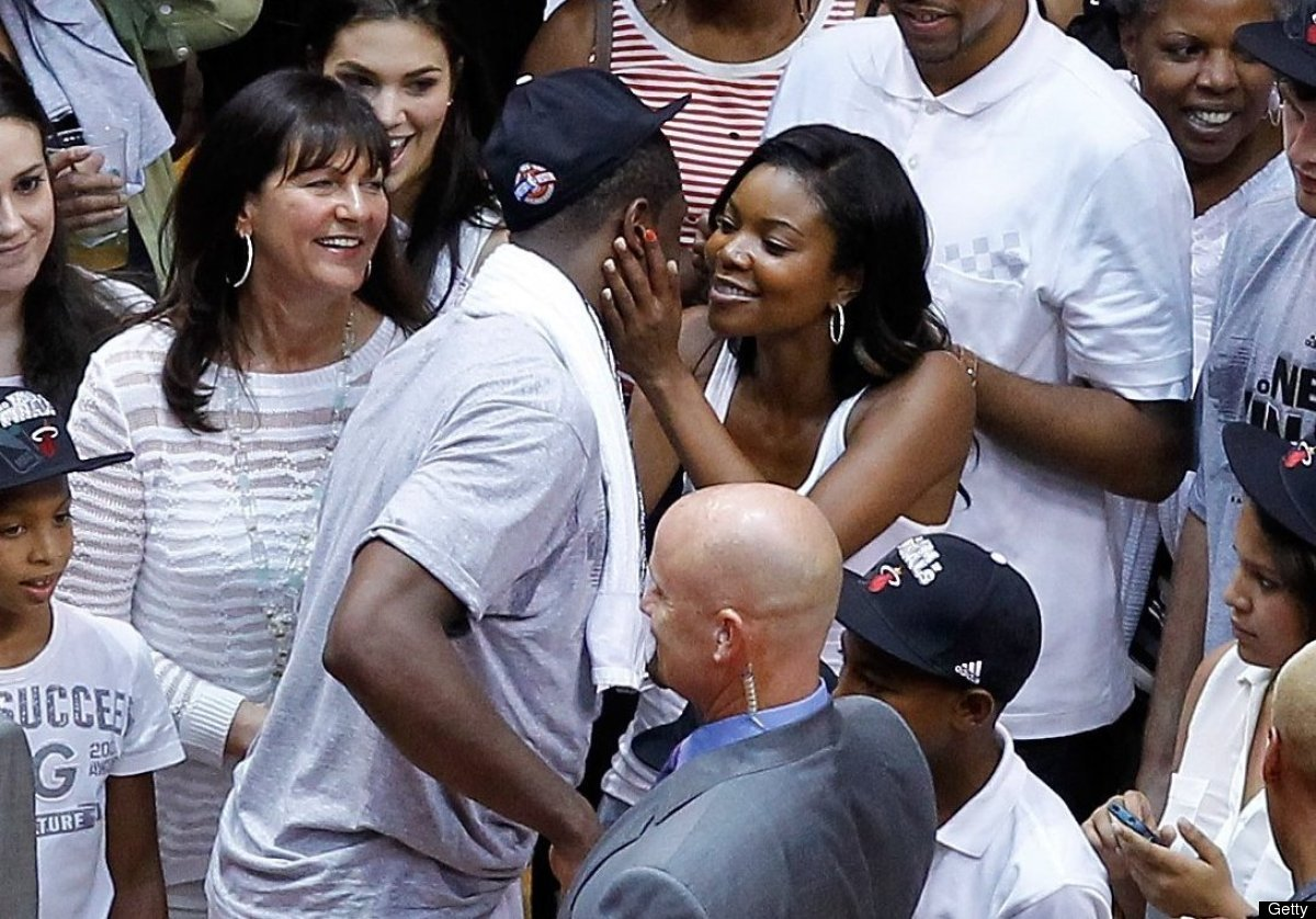 MIAMI, FL - JUNE 09:  Dwyane Wade #3 of the Miami Heat celebrates as he kisses girlfriend actress Gabrielle Union after the H