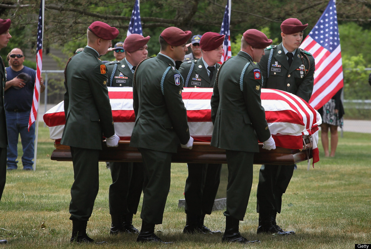 WHEATON, IL - MAY 30:  Soldiers from the 82nd Airborne carry the remains of  U.S. Army SPC Samuel Watts to his grave on May 3