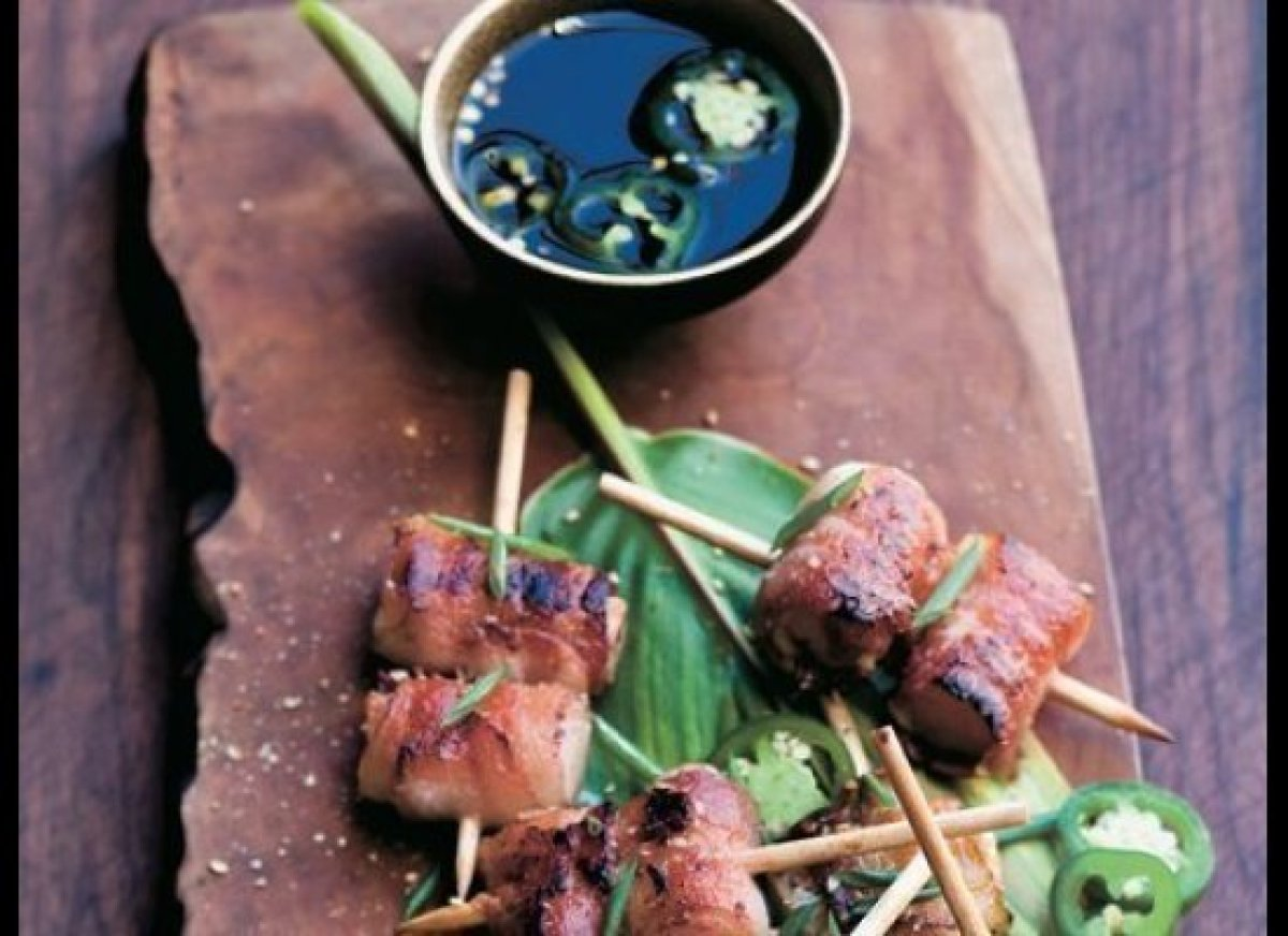 """To start, dunk some gilled bacon parcels into a spicy, savory ponzu sauce.   <b>Get the <a href=""""LINK TK"""" target=""""_blank"""">B"""