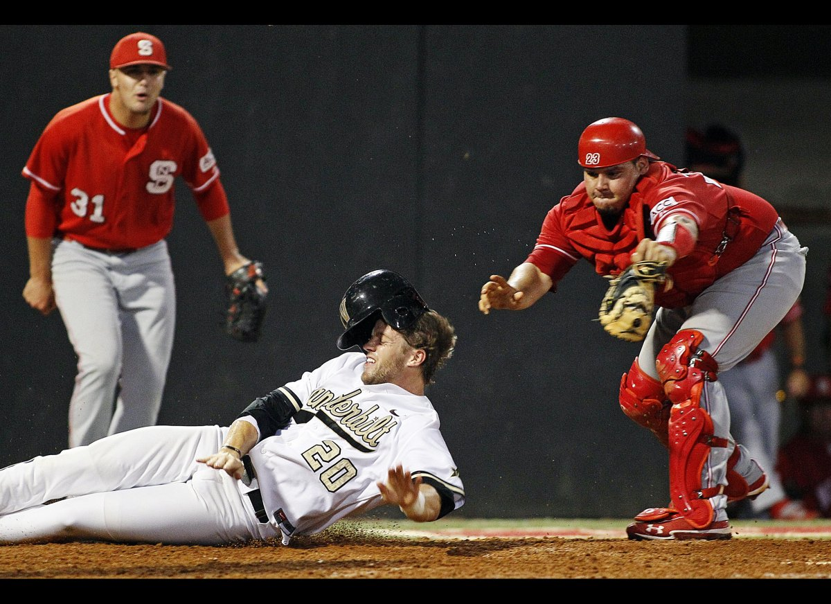 North Carolina State's Danny Canela, right, tags out Vanderbilt's Connor Harrell (20) as North Carolina State's Ryan Wilkins