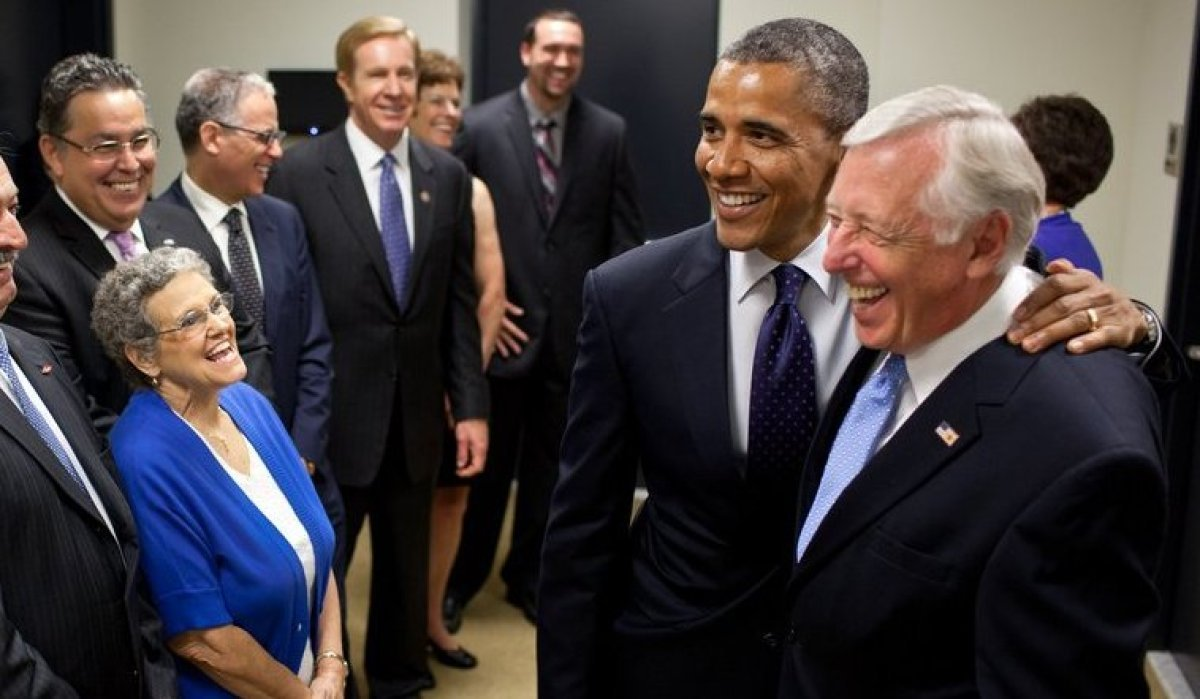 President Barack Obama greets Minority Whip Steny Hoyer and ceremony participants backstage before the signing of the Export-