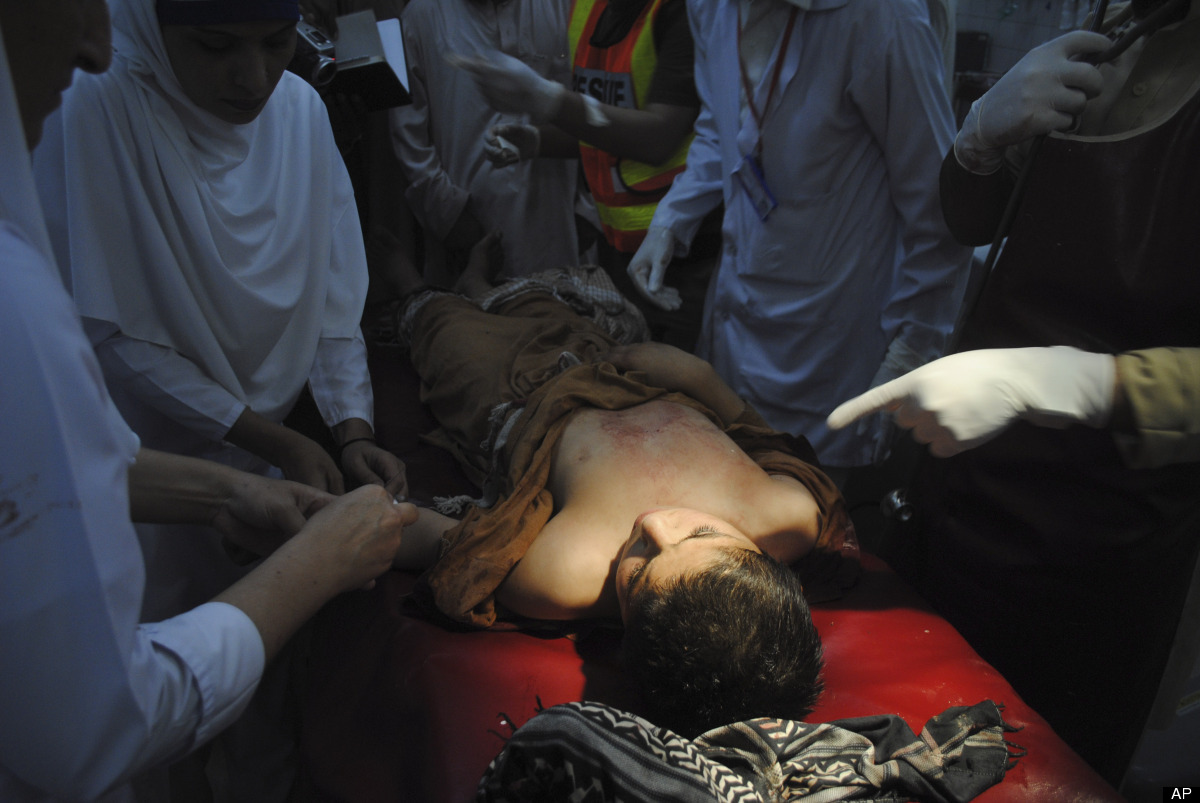 Photo: A Pakistani boy, who was injured in a suicide attack, receives treatment at a hospital in Peshawar, Pakistan, Tuesday,