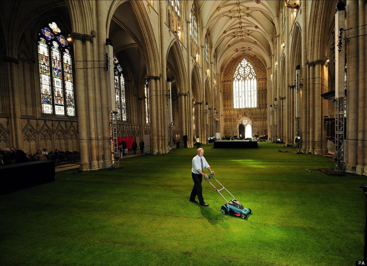 The Nave of York Minster covered in 1500 square metres of real grass as the Minster is prepared for the York Minster Rose Din