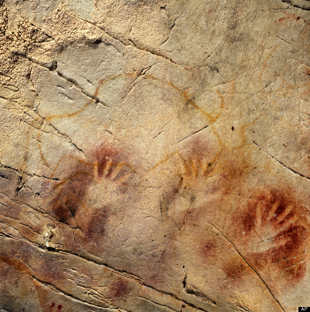 This undated handout photo provided by pedro suara/aaas shows detail of the 'Panel of Hands', El Castillo Cave, Spain, showin