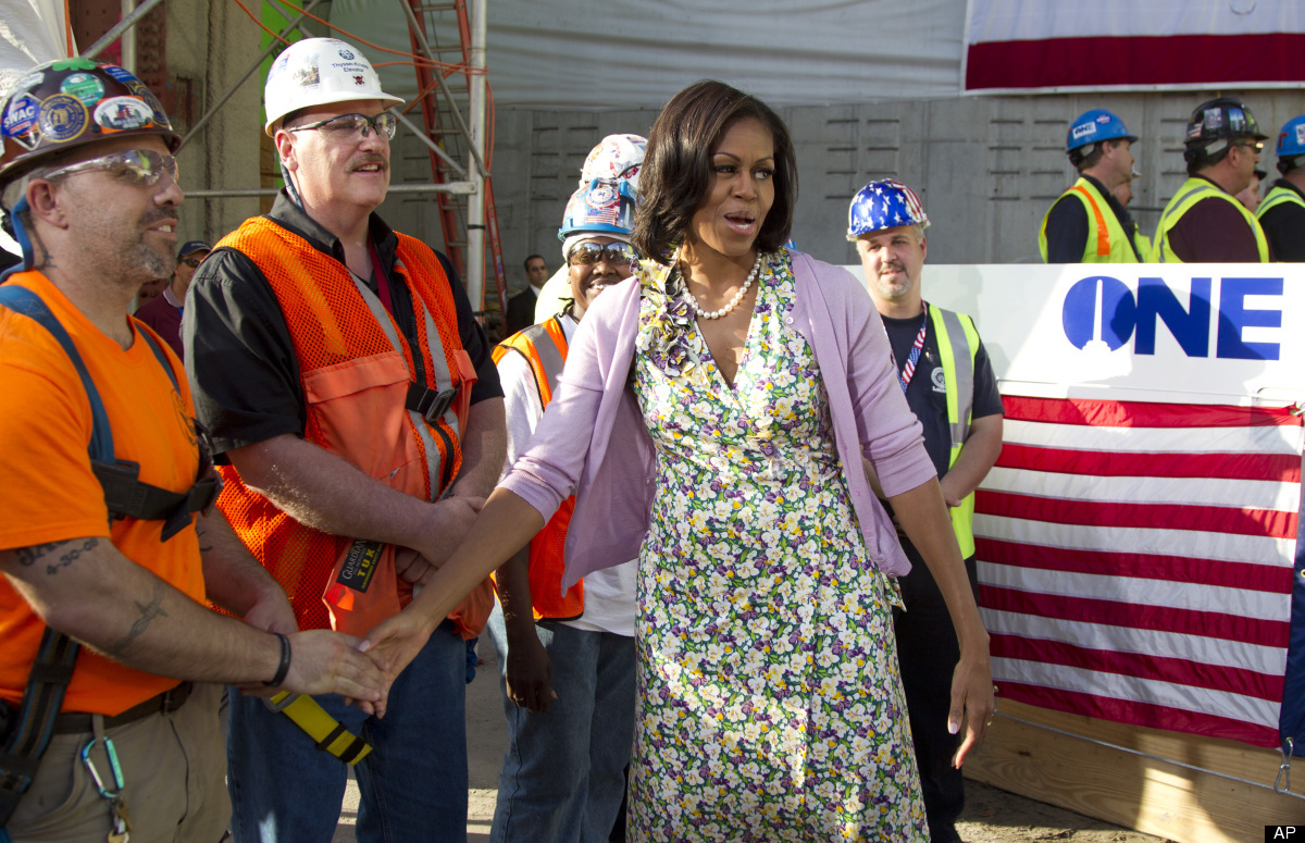 First lady Michelle Obama greets workers during a visit to the Port Authority of New York and New Jersey's World Trade Center