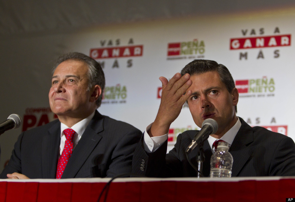 Presidential candidate Enrique Pena Nieto, right, of the Institutional Revolutionary Party and Colombian retired Gen. Oscar N