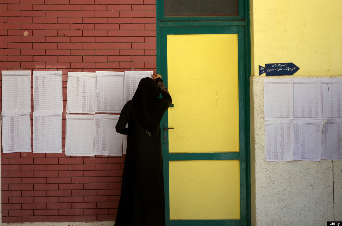 An Egyptian veiled woman looks for her name on the registered voters' list in the second round of the historical presidential