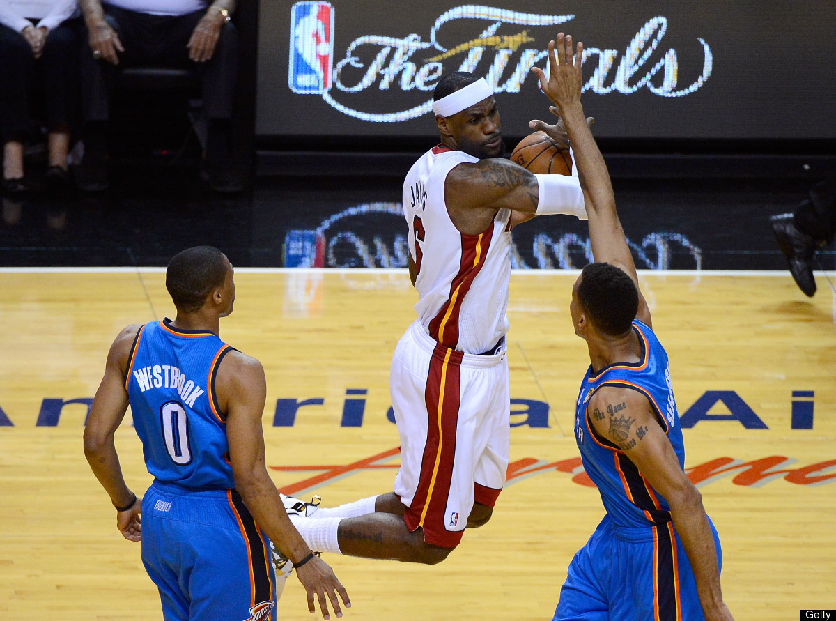 LeBron James #6 of the Miami Heat attempts to control the ball in the first quarter against Russell Westbrook #0 and Thabo Se