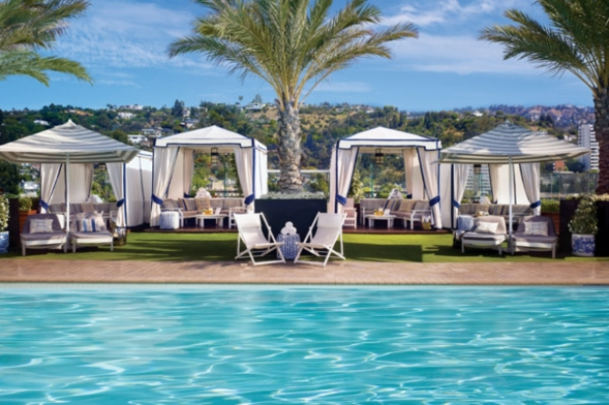 "With its nautical color theme and cozy cabanas the pool area at the <a href=""http://www.thelondonwesthollywood.com/"" target="""