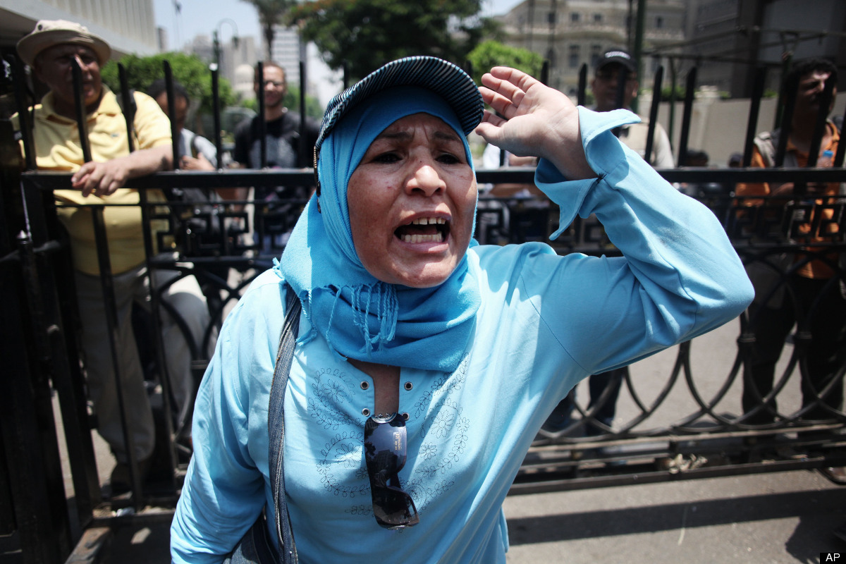 An Egyptian woman chants anti-Supreme Council for the Armed Forces (SCAF) slogans outside the Egyptian Parliament in Cairo, E
