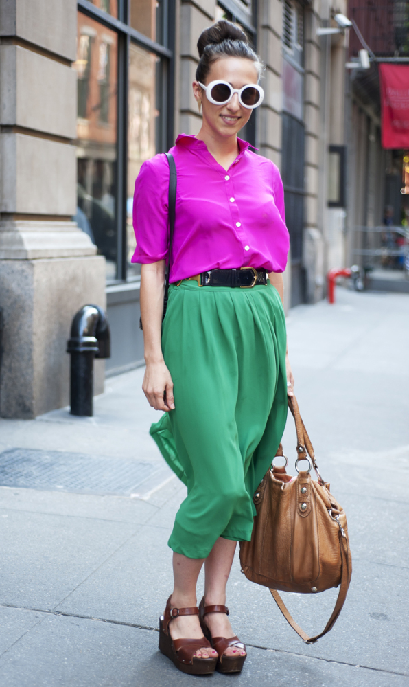 Wearing top, skirt, and sunglasses all from little boutiques around the city, Topshop earrings, and Linea Pelle bag