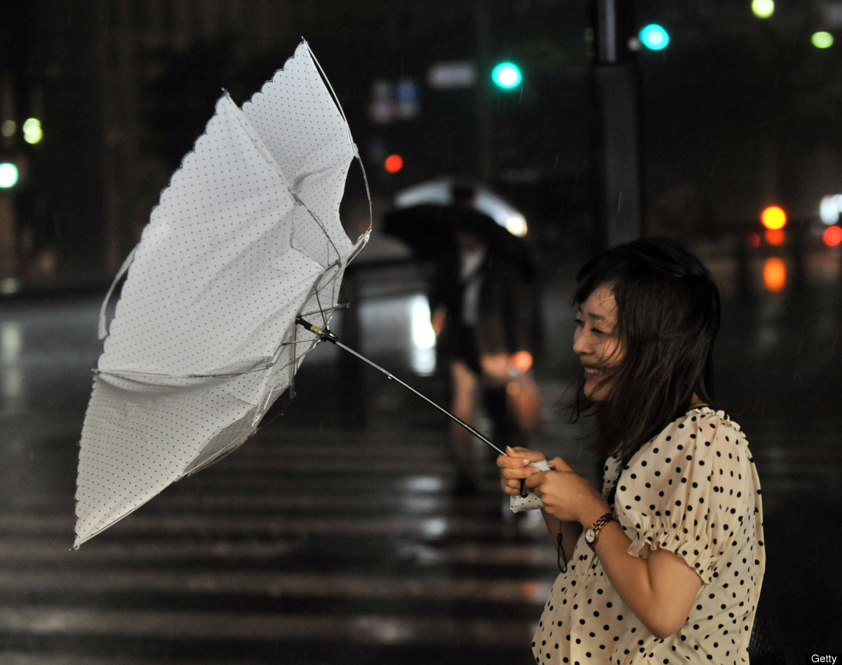 A woman walks against strong winds in Tokyo on June 19, 2012. (YOSHIKAZU TSUNO/AFP/GettyImages)