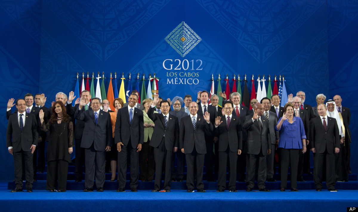 President Barack Obama takes his place with other leaders for the family photo during the G20 Summit, Monday, June 18, 2012,