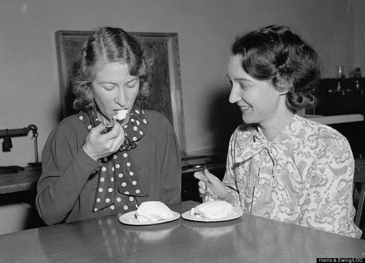 Two Department of Agriculture employees, Mary E. Sarber and Luella Dever, taste-test ice cream made with salt-preserved cream