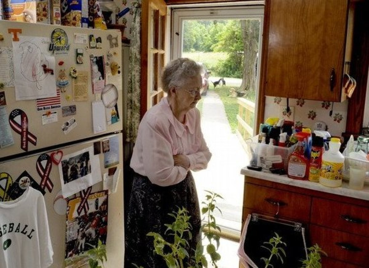 Mary Cate Jones stands the home she and her husband Kenneth built 56 years ago. Jones, 78, has received notice that at 8 a.m.