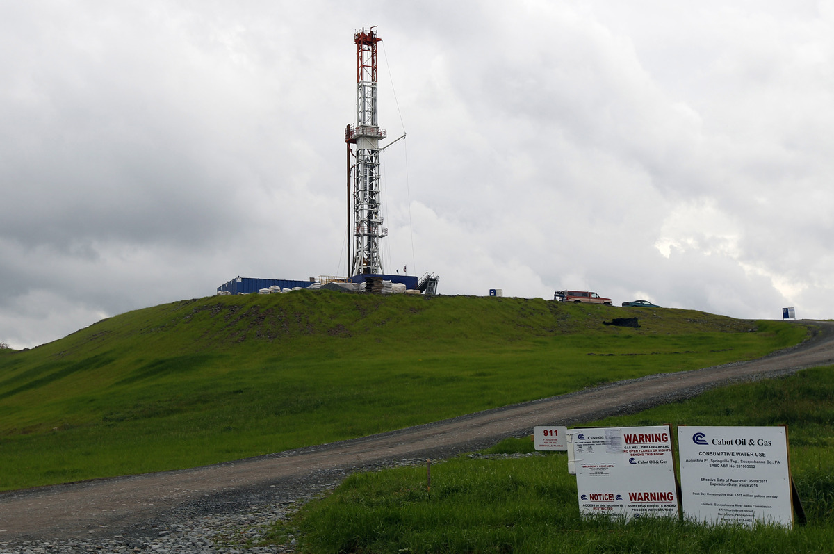 In this file photo from Oct. 14, 2011, a drilling rig is seen in Springville, Pa. State regulators blamed faulty gas wells dr