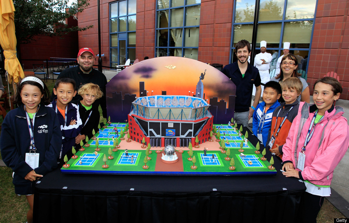 """A replica of the USTA Billie Jean National Tennis Center. Duff Goldman and his """"Ace Of Cake"""" co-stars stand with a group of c"""