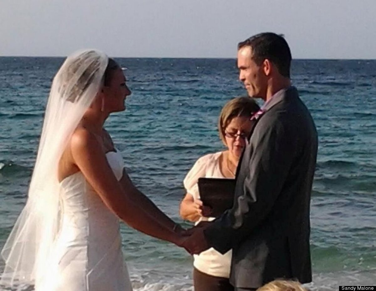 Sandy Malone: The new Dr. and Mrs. Francisco and Leslie Ramirez exchanging vows on the beach on Vieques Island Saturday. (Our
