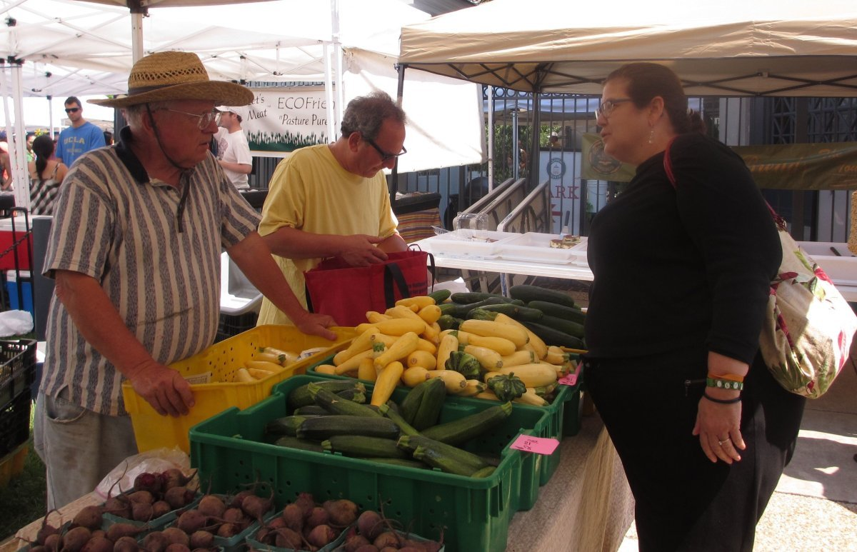Lacoste chats with Jim Breger of Anchor Nurseries. She often stocks up on flowers and veggies at Breger's market stall.