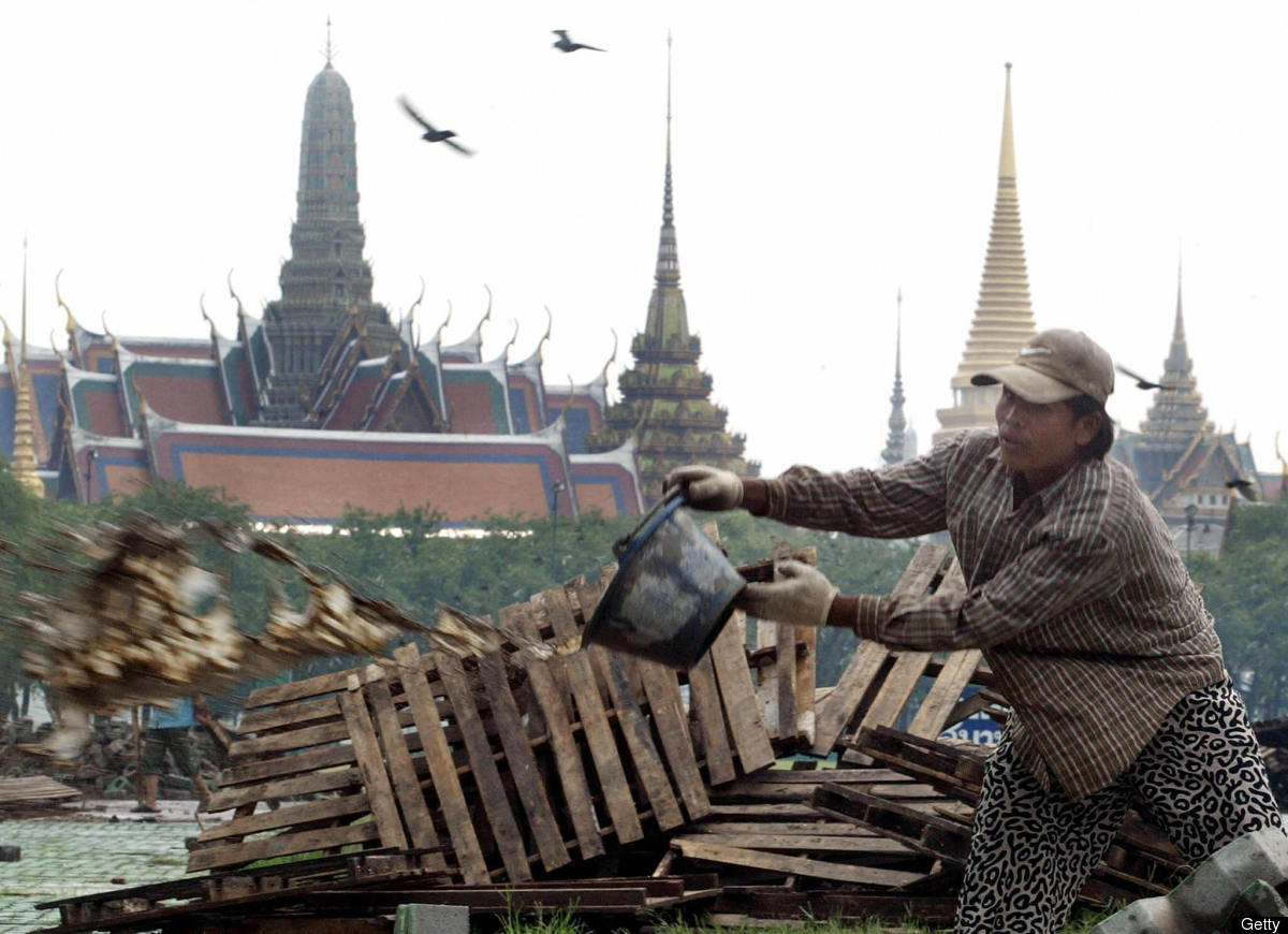 A Thai worker cleans up in front of the Royal Palace ahead of Asia-Pacific Economic Cooperation summit in Bangkok in October