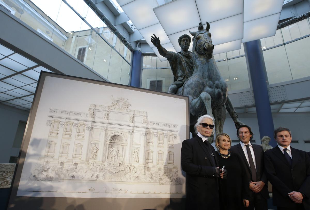 From left, Designer Karl Lagerfeld, Silvia Venturini Fendi, Fendi CEO Pietro Beccari and Rome's Mayor Gianni Alemanno, pose f