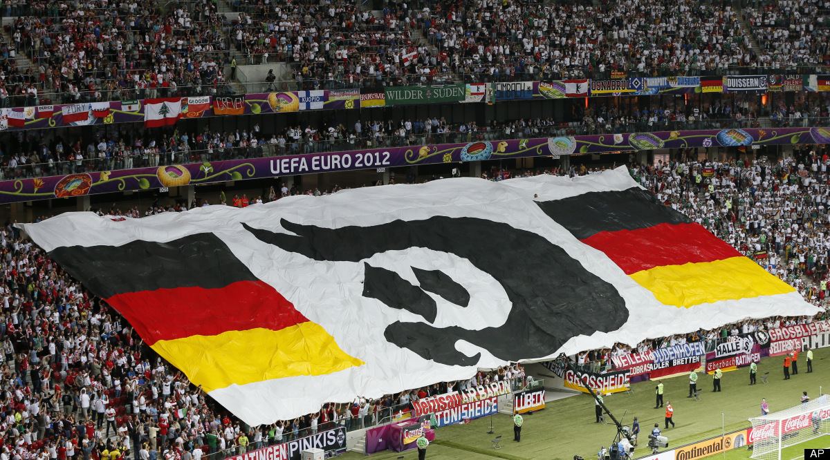 Fans hold a giant banner with the German colors prior to the Euro 2012 soccer championship semifinal match between Germany an