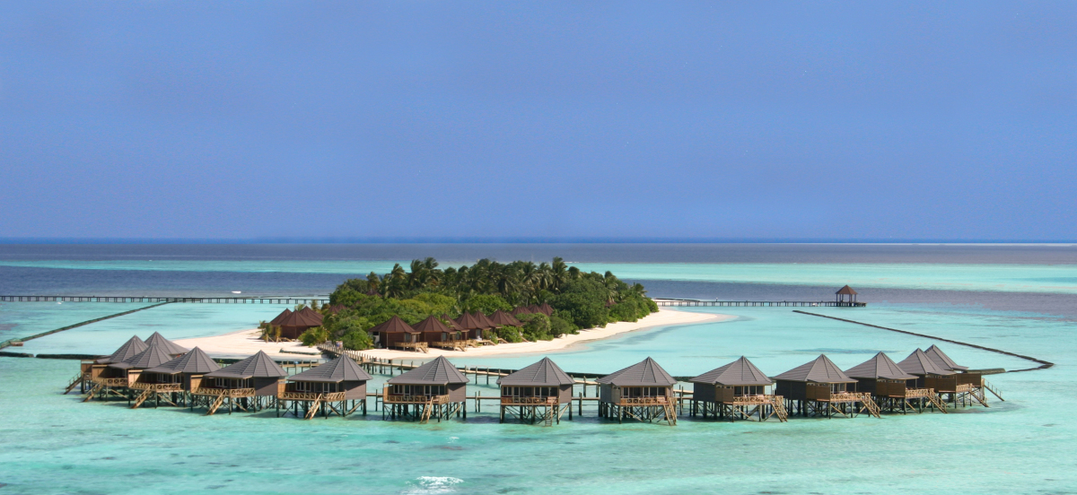 Surrounded by a rainbow-colored coral reef, turquoise blue water and sandy white beaches, the Kuredu Island Resort welcomes n