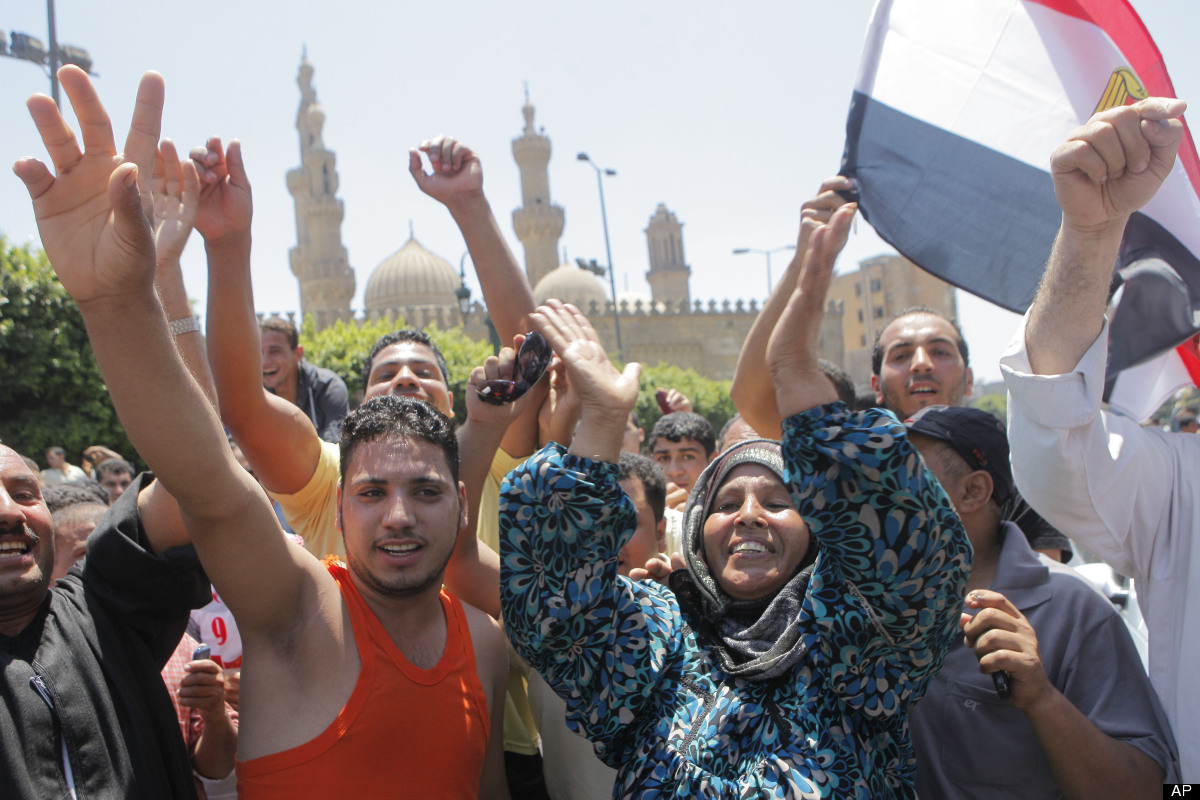 Egyptians greet President-elect Mohammed Morsi, not pictured, following Friday prayers at Al-Azhar mosque, in Cairo, Egypt, F