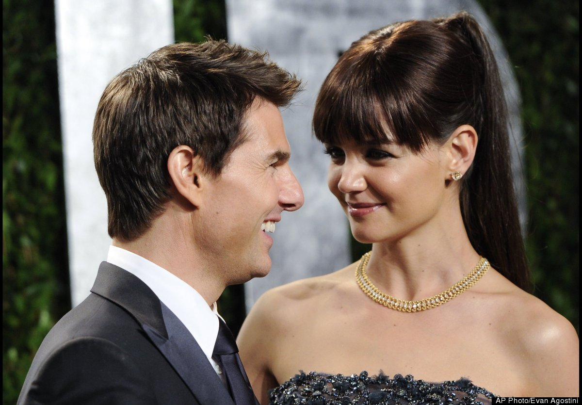 Actors Tom Cruise and Katie Holmes arrive at the Vanity Fair Oscar party on Sunday, Feb. 26, 2012, in West Hollywood, Calif.