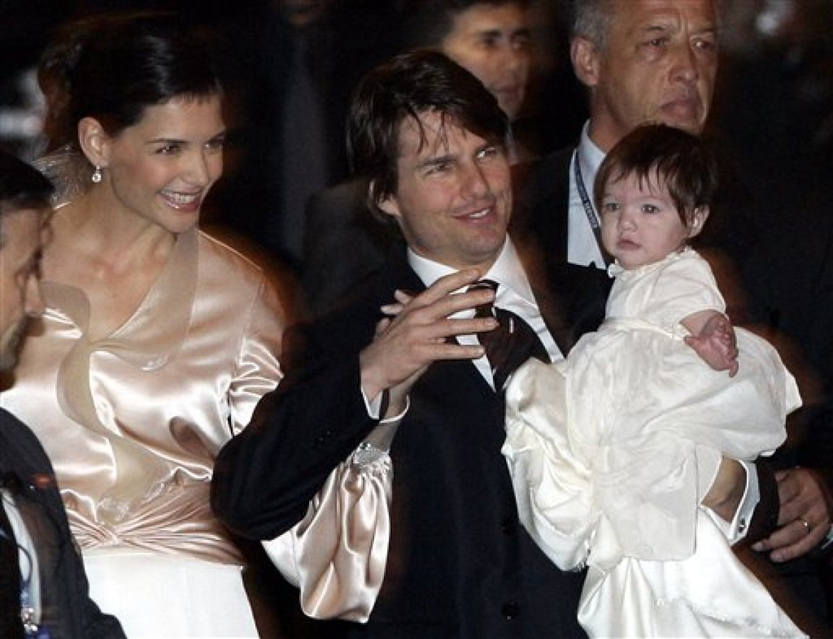 U.S. actor Tom Cruise, and U.S. actress Katie Holmes with their daughter Suri, leave a restaurant in Rome, early Friday Nov.