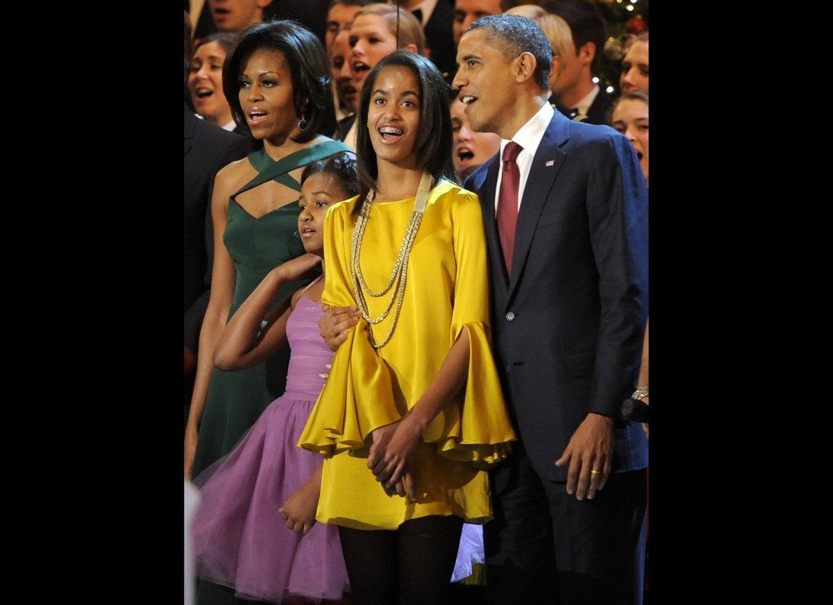 WASHINGTON, DC - DECEMBER 11: (AFP OUT) (L-R) First lady Michelle Obama, Malia, Sasha and U.S. President Barack Obama join in