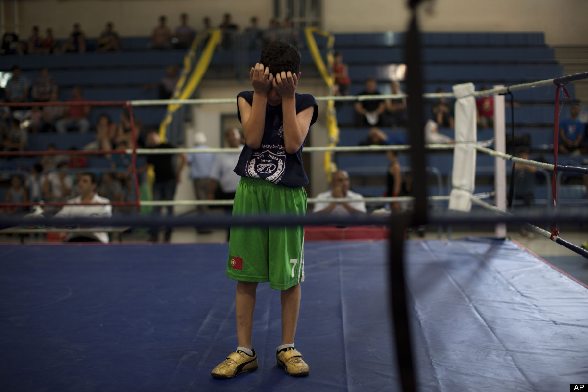 In this picture taken on Friday, June 29, 2012, a young Israeli Arab boxer cries after he lost a fight during the Israel's Na