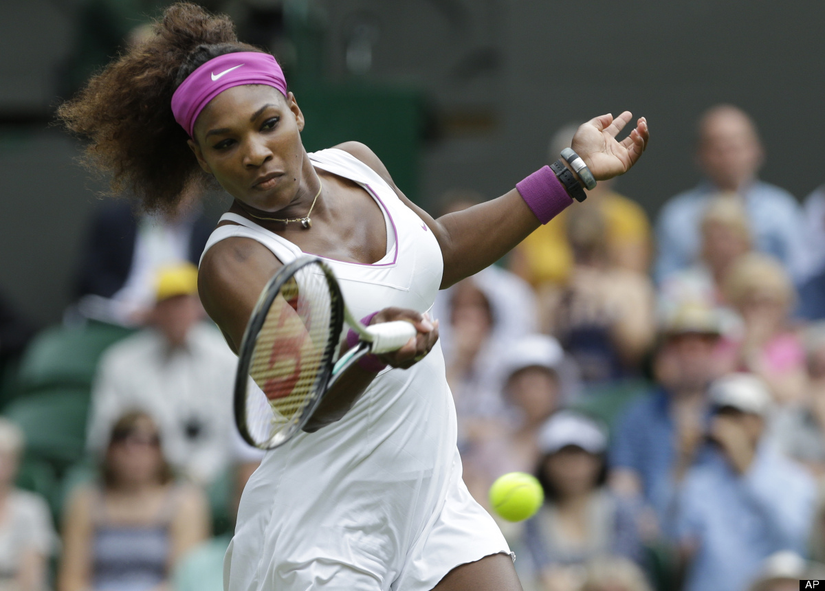 Serena Williams of the United States plays a shot to Victoria Azarenka of Belarus during a semifinals match at the All Englan