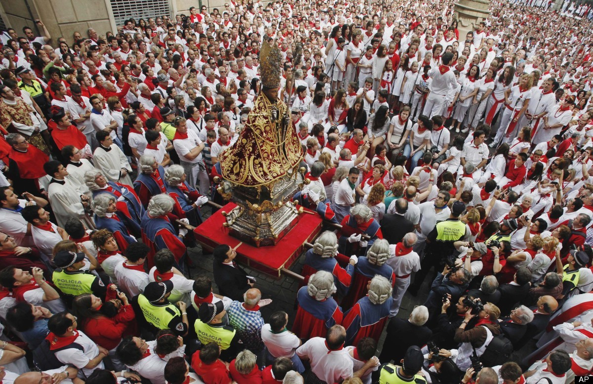 An image depicting San Fermin, the patron saint of Pamplona, is carried to the church in the middle of a procession during th