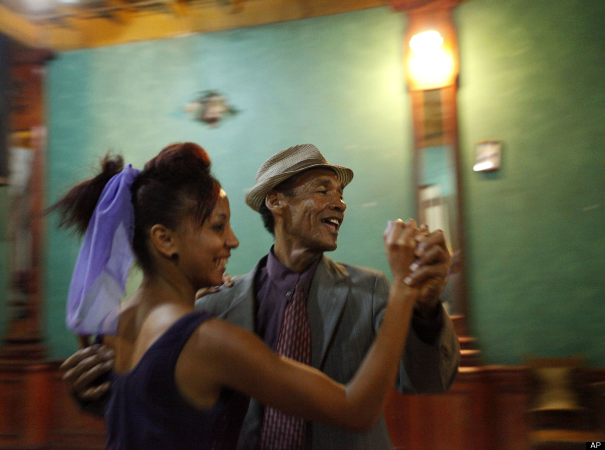 This April 26, 2012, photo shows performers dancing to live music at Casa de la Trova, house of troubadors, in Santiago de Cu