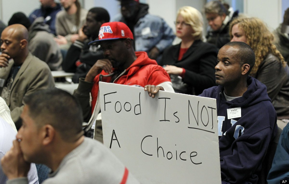A man holds a sign during a Philadelphia Department of Public Health hearing in reference to regulations banning outdoor food