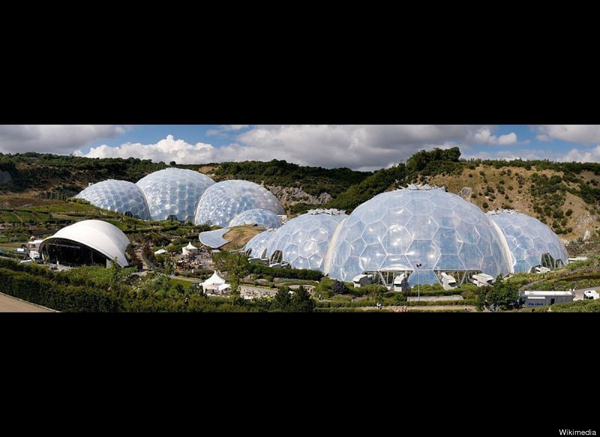 Panoramic view of the geodesic dome structures of the Eden Project, a large-scale environmental complex in the UK conceived b