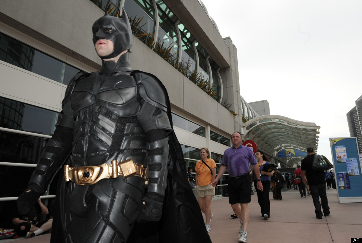 Fans arrive at the San Diego Convention Center before preview night at Comic - Con on Wednesday July 11, 2012, in San Diego.