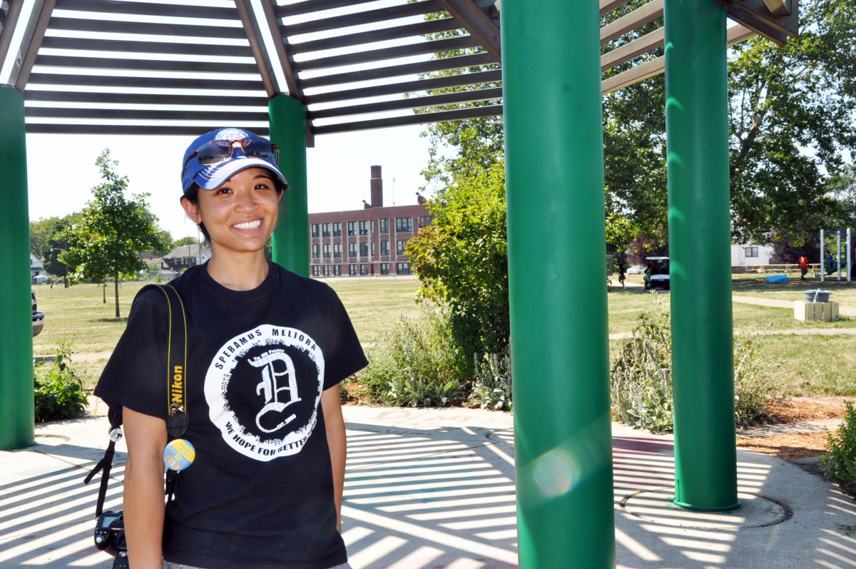 313 Project cofounder Aisa Villarosa stands under the brightly painted gazebo after a long day of work at Romanowski Park.