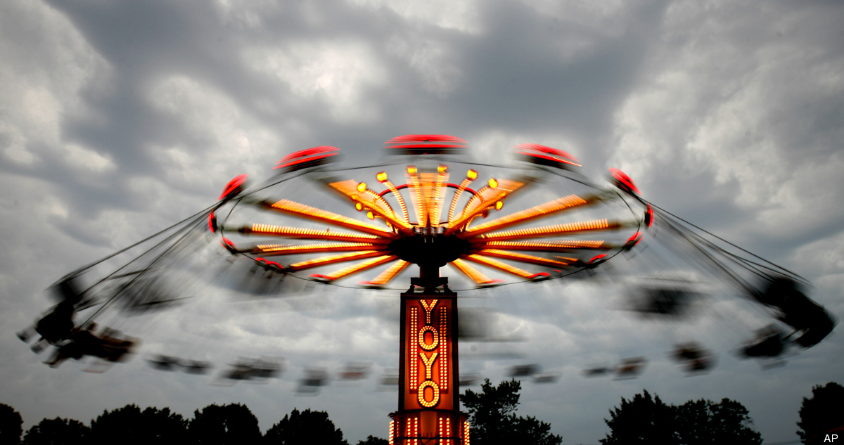 A passing storm brought a halt to rides Friday, June 29, 2012 at the 26th annual Italian-American Festival being held this we