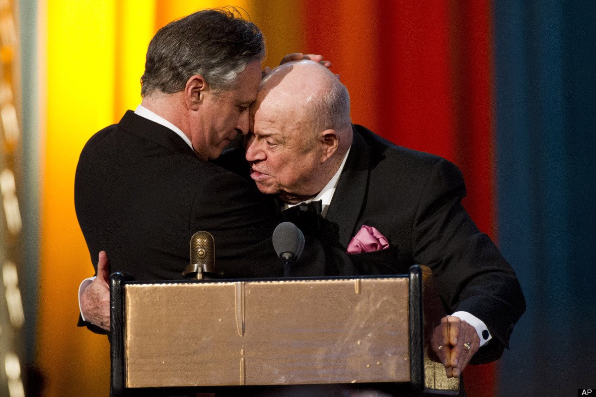 Jon Stewart, left, presents Don Rickles with the Johnny Carson Award at The 2012 Comedy Awards in New York, Saturday, April 2