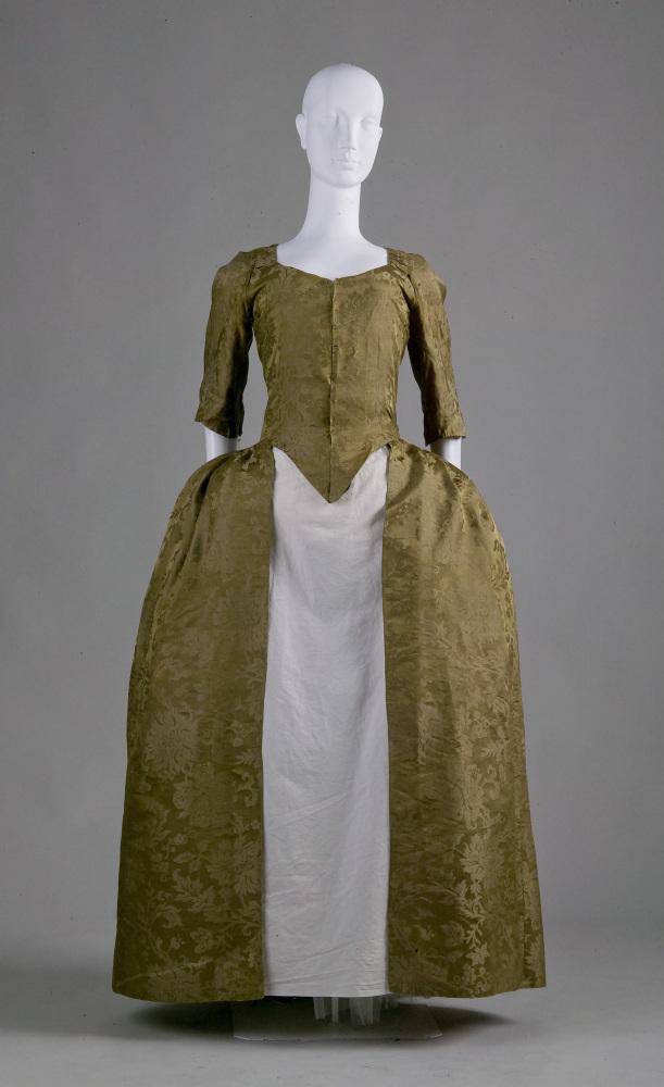 This wedding dress was originally worn by the great-great-great-great-grandmother of the donor. The homespun linen lining of