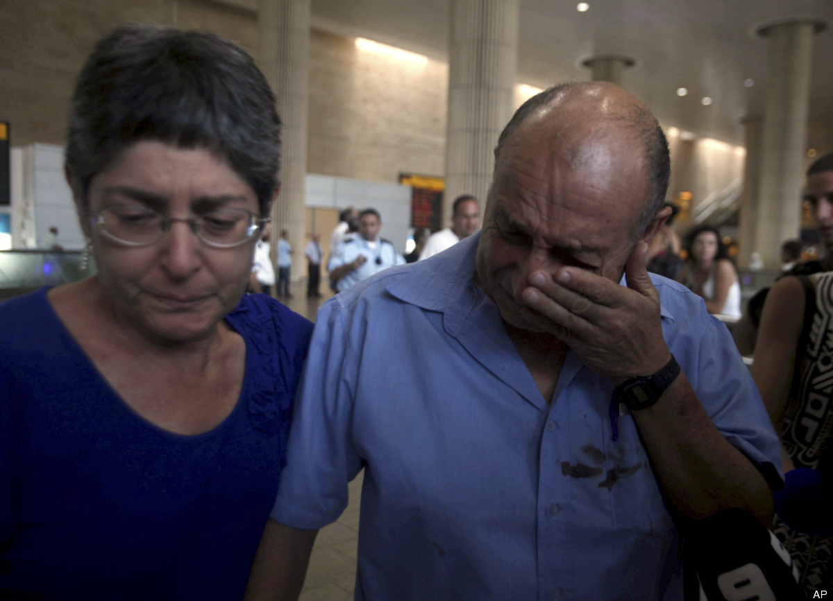 A Israeli survivor from a bombing in Bulgaria that killed seven people on Wednesday, cries as he arrives at the Ben Gurion ai
