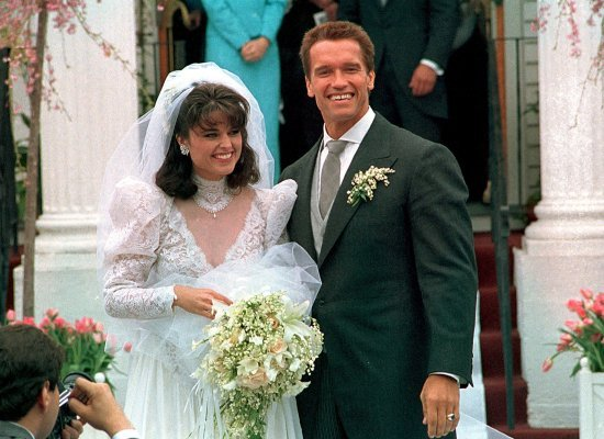 In an April 25, 1986 file photo Actor Arnold Schwarzenegger poses with his bride Maria Shriver following their wedding ceremo