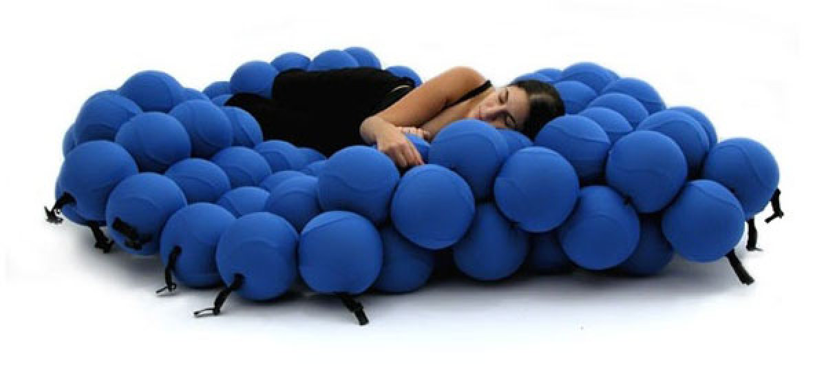 This bed definitely has a lot of imagination. It's made of 120 soft, foam balls that can transform into different sleeping po