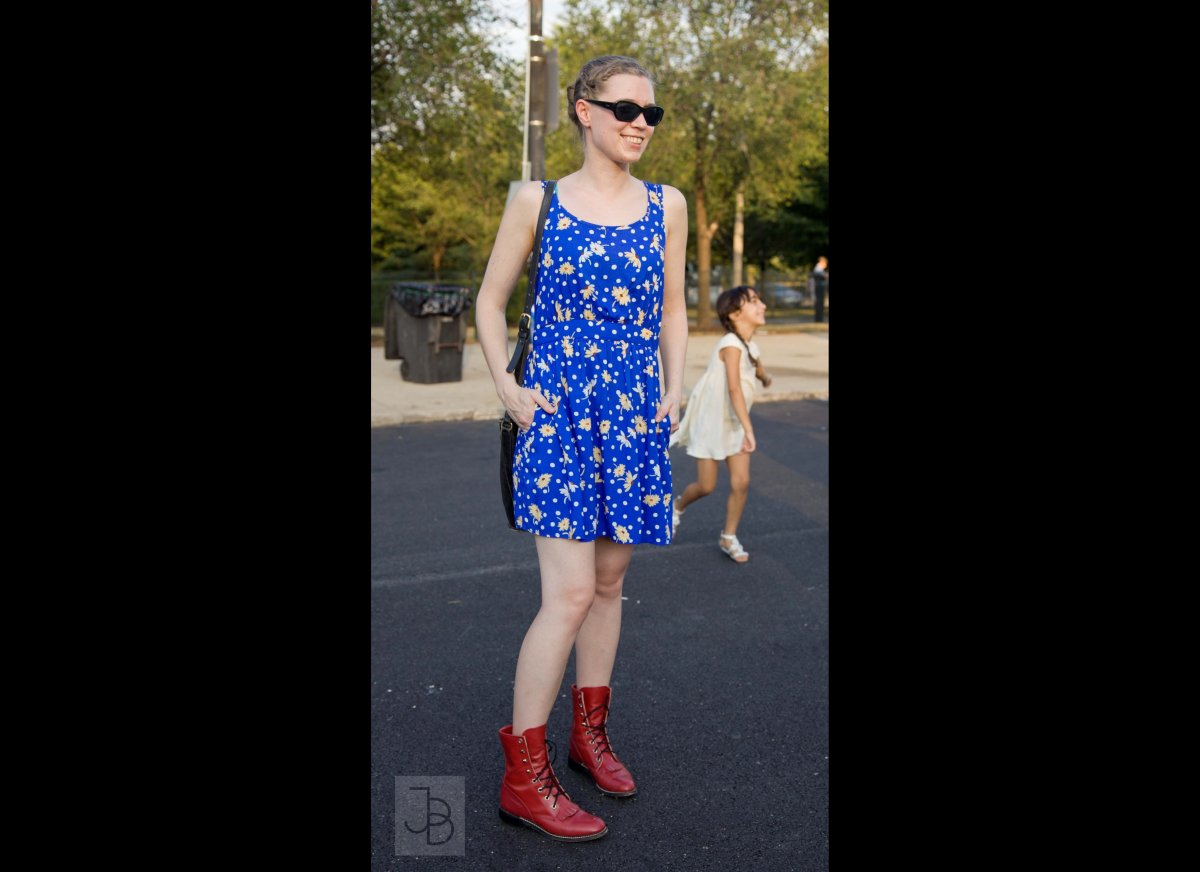 Heather takes a flirty azure sun dress and mixes it with a hard-edged pair of bright red leather boots. The polka dots and da