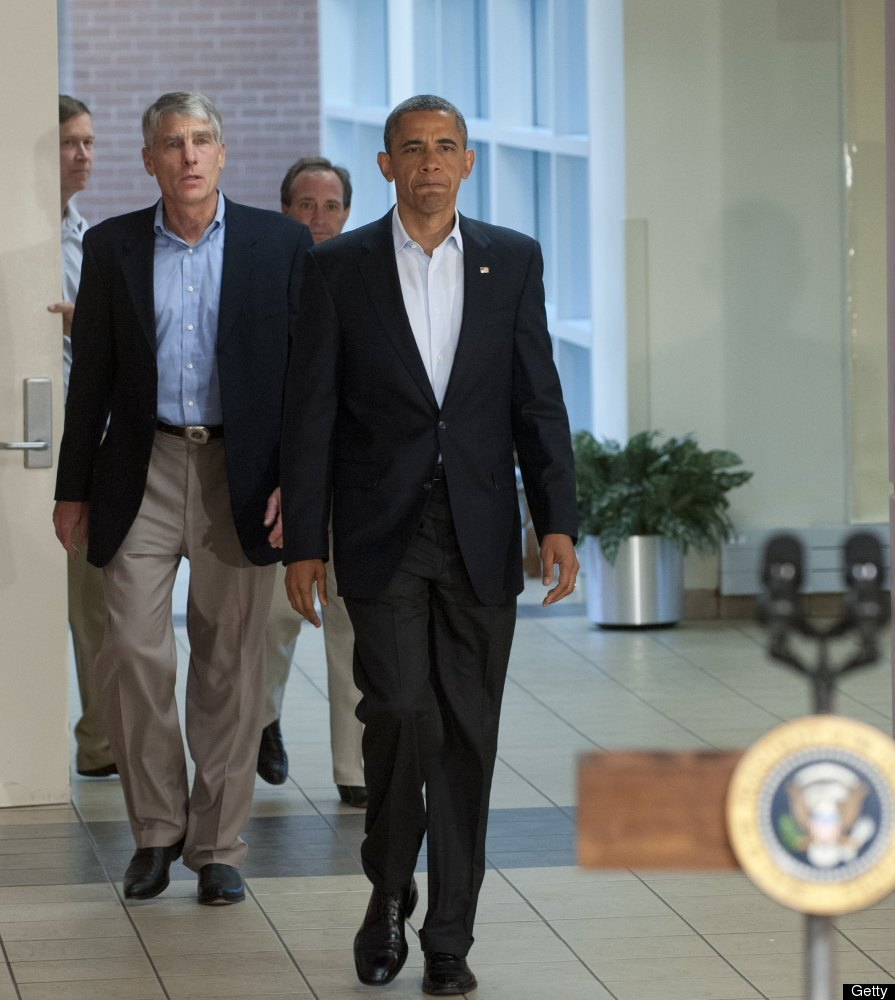 US President Barack Obama arrives alongside Colorado Senator Mark Udall (L) to speak at the University of Colorado Hospital i