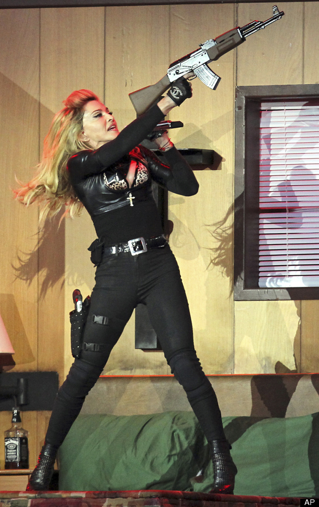 Madonna performs on stage in Hyde Park, London, as part of her MDNA concert tour, Tuesday July 17, 2012. (AP Photo / Sean Dem