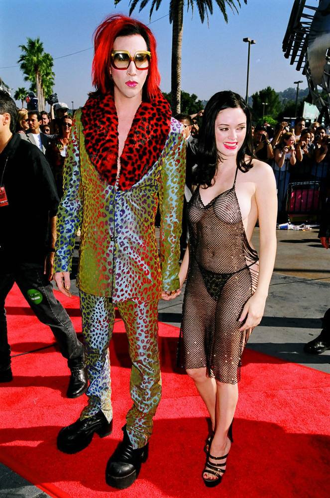 Rose McGowan's intentional wardrobe malfunction at the 1998 MTV Video Music Awards with then boyfriend Marilyn Manson.    (