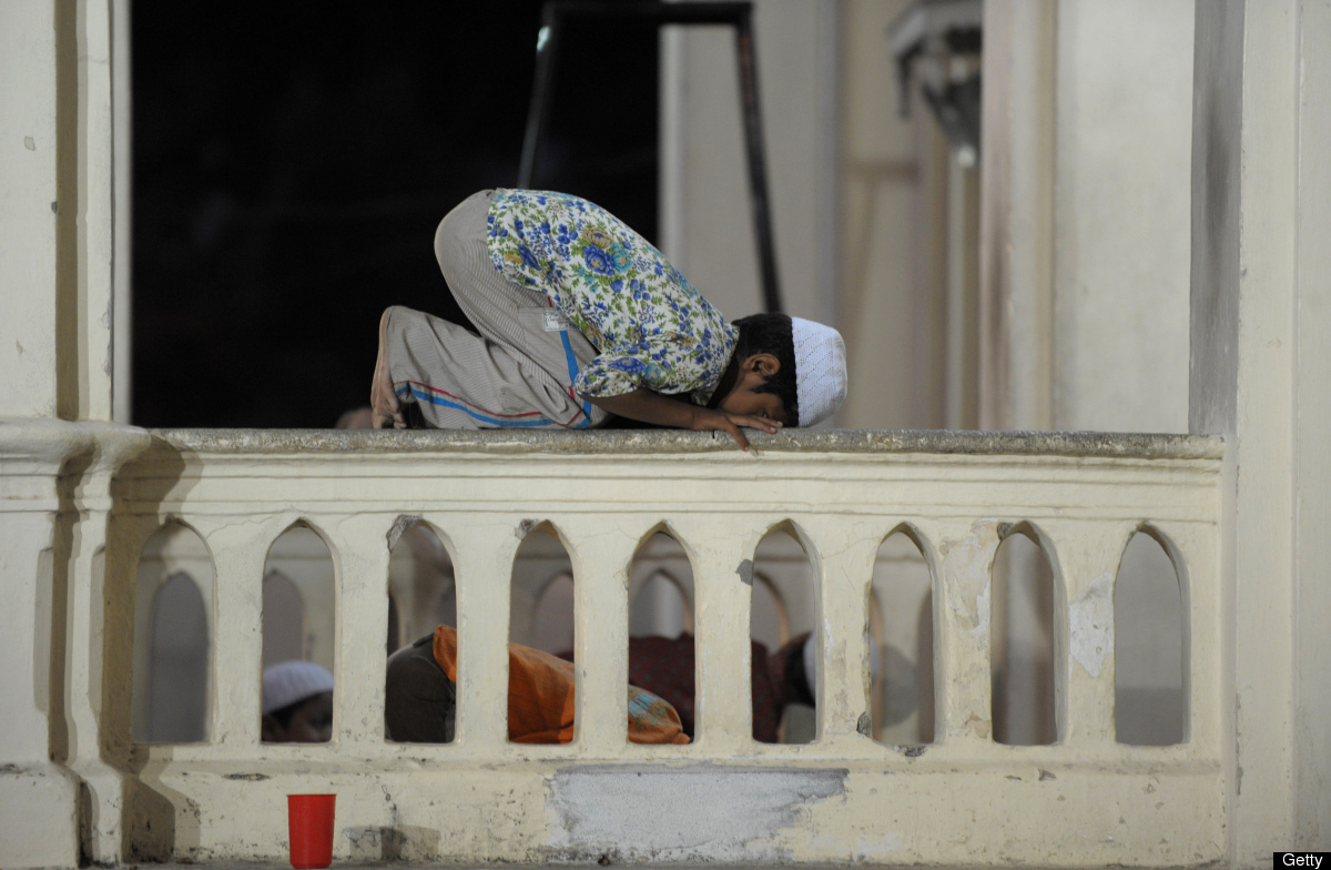 An Indian Muslim boy offers prayers at Jama-e-Masjid Aiwan-e-Begumpet mosque during the holy month of Ramadan in Hyderabad on